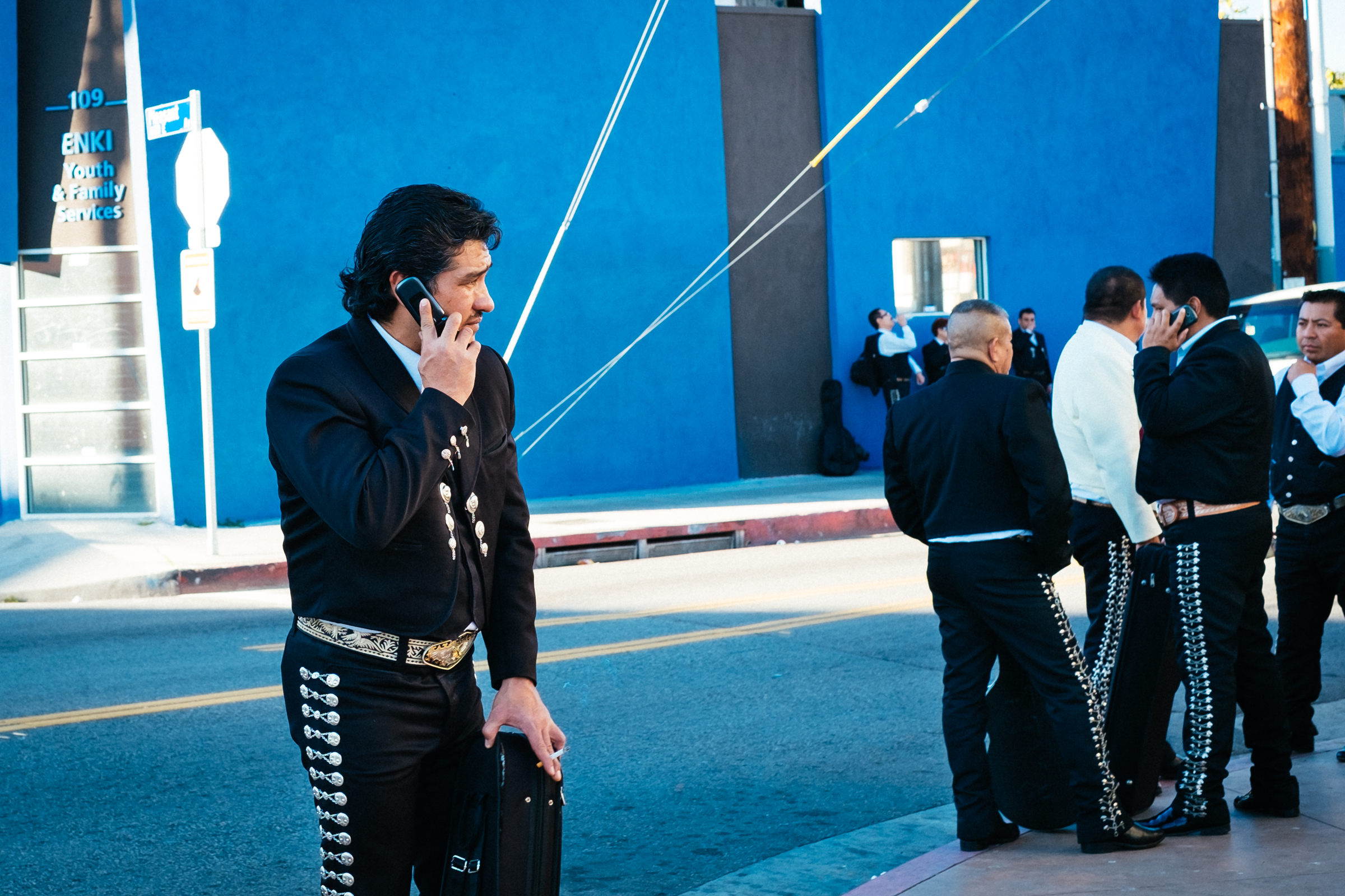 Boyle Heights Mariachi talking on the phone